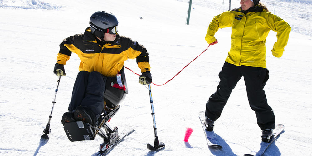 Dana Polonsky skis at 2018 Wells Fargo Cup where Craig Hospital announces partnership with NSCD to promote adaptive sports and recreation opportunities for community.