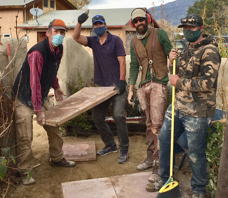 Andrew Hay's four friends creating a flagstone path in his yard