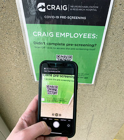 A phone using the QR code for the app.