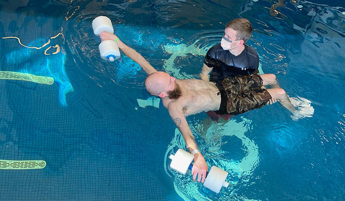 Robbie in pool therapy at Craig Hospital