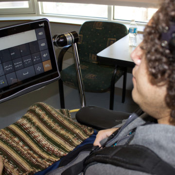 Miguel Garcia Vazquez learns to speak with the Tobii Dynavox I-Series device in the Augmentative and Alternative Communication (AAC) program in Craig Hospital's Assistive Technology Lab.