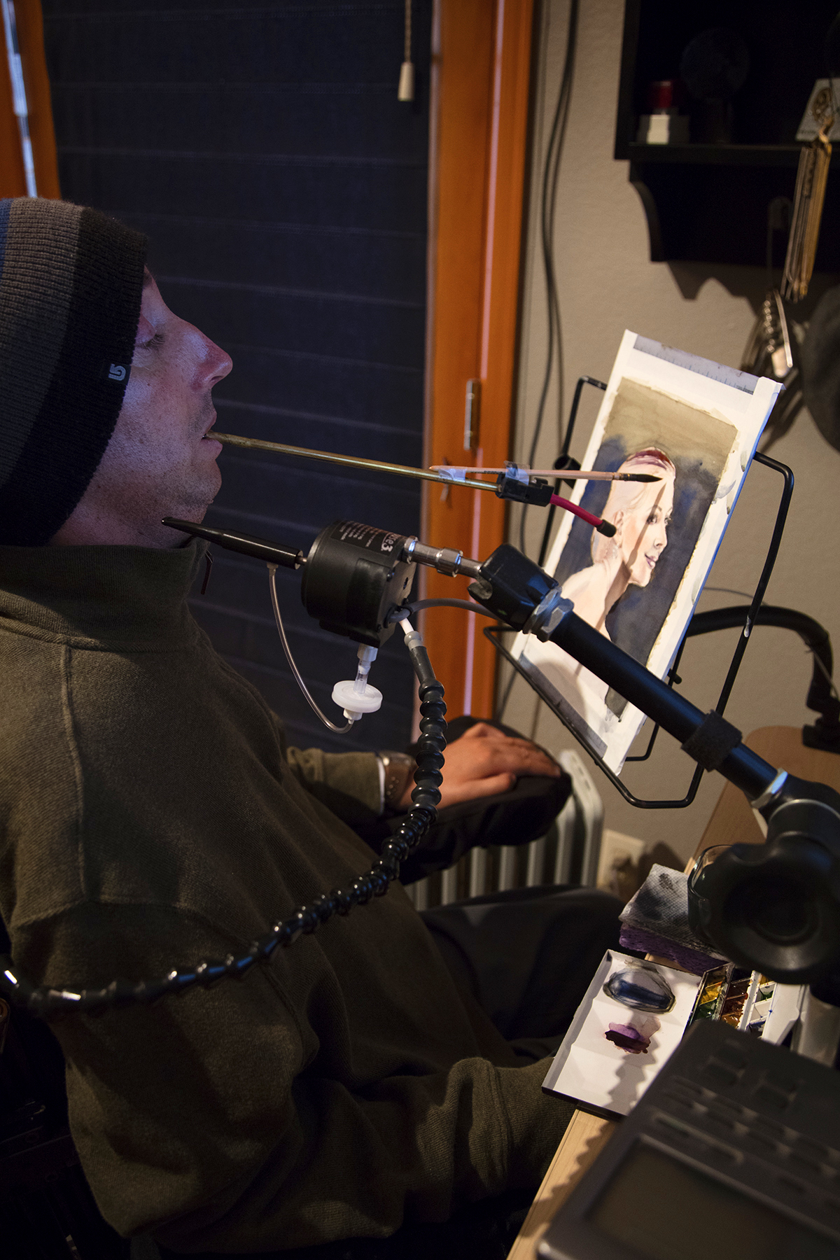 Quadriplegic and Craig Hospital SCI Rehabilitation Graduate Brett Colonell uses form-fitting mouth sticks to paint