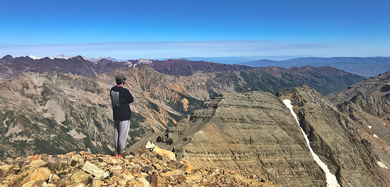 James Hall on summit of a Colorado mountain