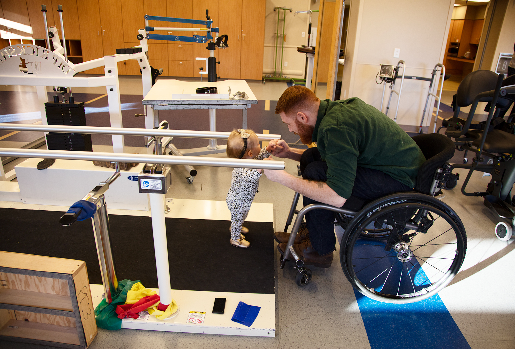 Spinal cord injury rehabilitation patient Kaleb Wilson with his daughter at Craig Hospital