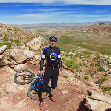 Craig Hospital brain injury graduate Thomas Pennell poses with his bicycle on a trip in Moab, Utah.