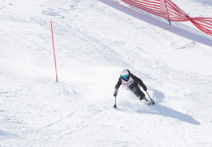 Paraolympian Alana Nichols skis at 2018 Wells Fargo Cup where Craig Hospital announces partnership with NSCD to promote adaptive sports and recreation opportunities for community.