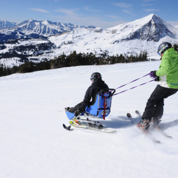 Spinal cord injury patients sit skiing in Crested Butte, Colorado with the therapeutic recreation program at Craig Hospital