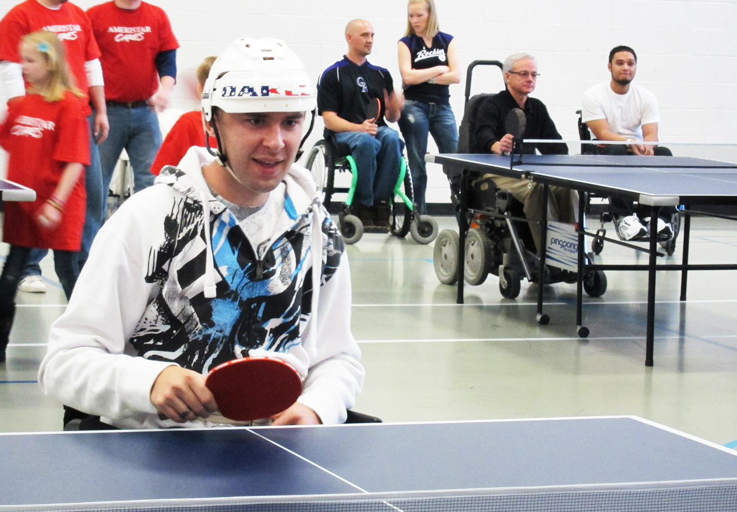 Spinal cord injury and brain injury patients playing ping pong with the therapeutic recreation program at Craig Hospital