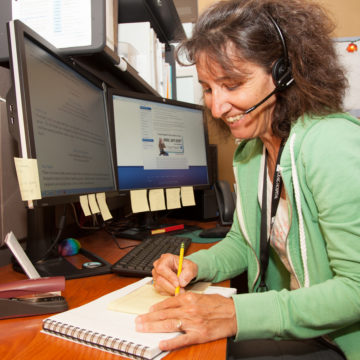 Nurse answering spinal cord injury and brain injury questions over the phone from Craig Hospital's Nurse Advice Line