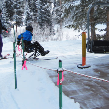 Craig Hospital | Spinal Cord Injury Rehabilitation Patient Participating in Adaptive Skiing Therapeutic Recreation Program