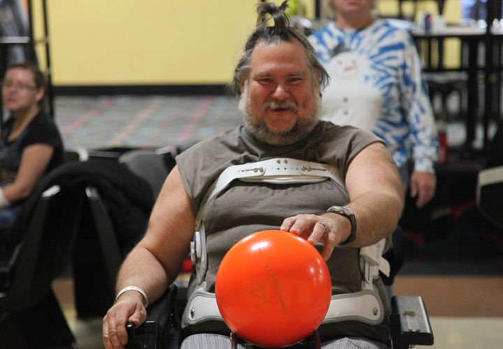 Patients with spinal cord and traumatic brain injury bowling in therapeutic recreation programs at Craig Hospital